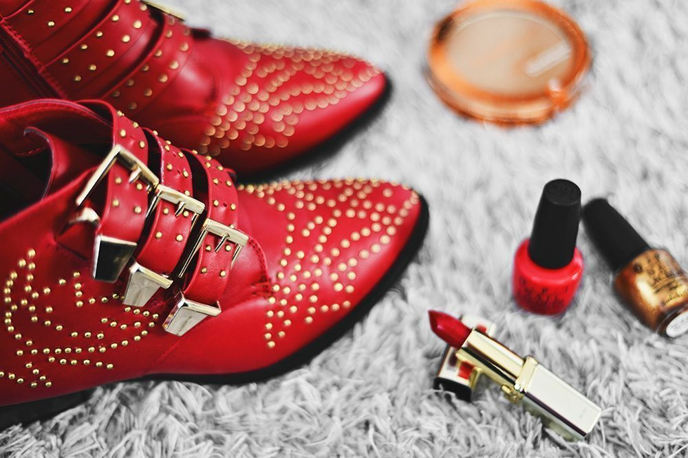 Red studded ankle boots