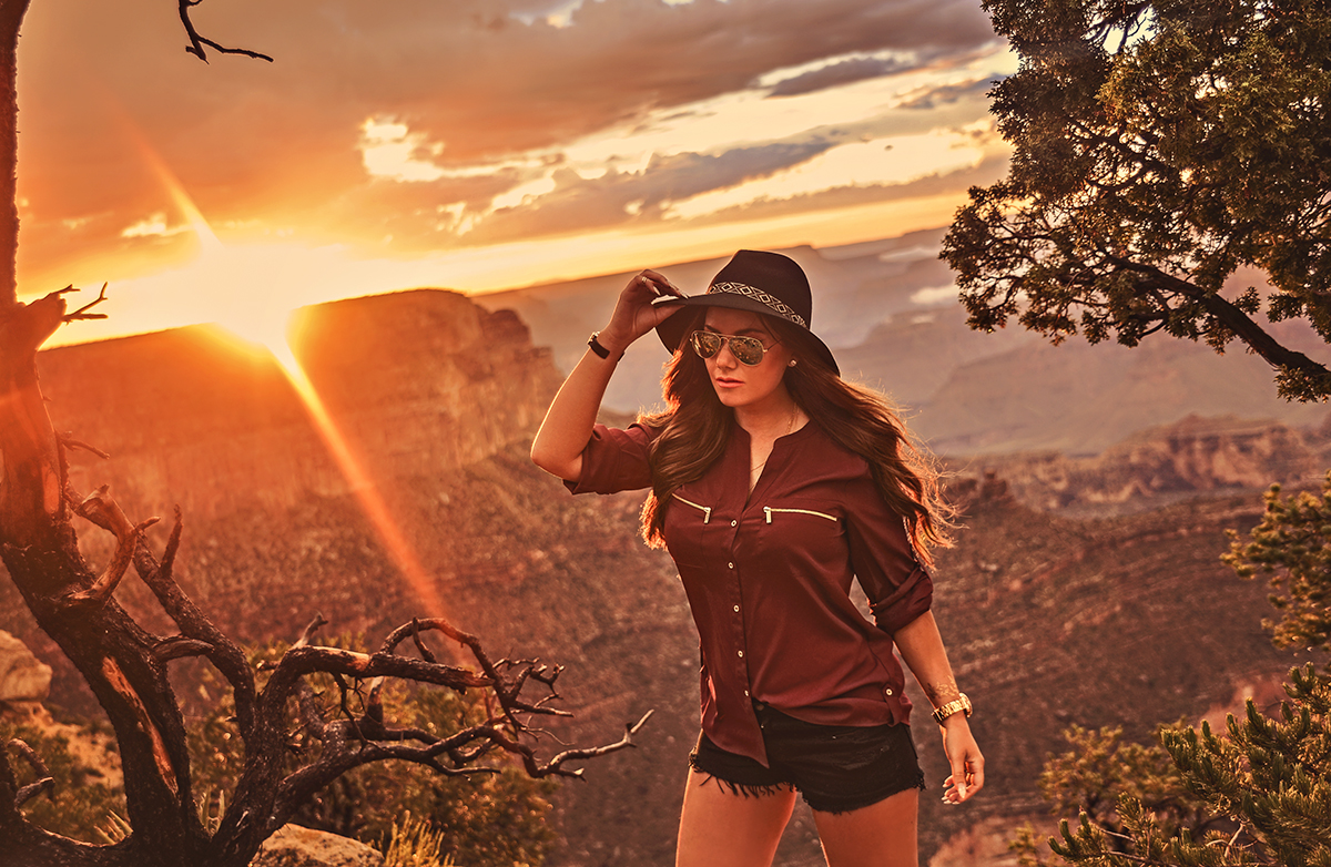 Young woman in Calvin Klein Top standing in the Grand Canyon sunset