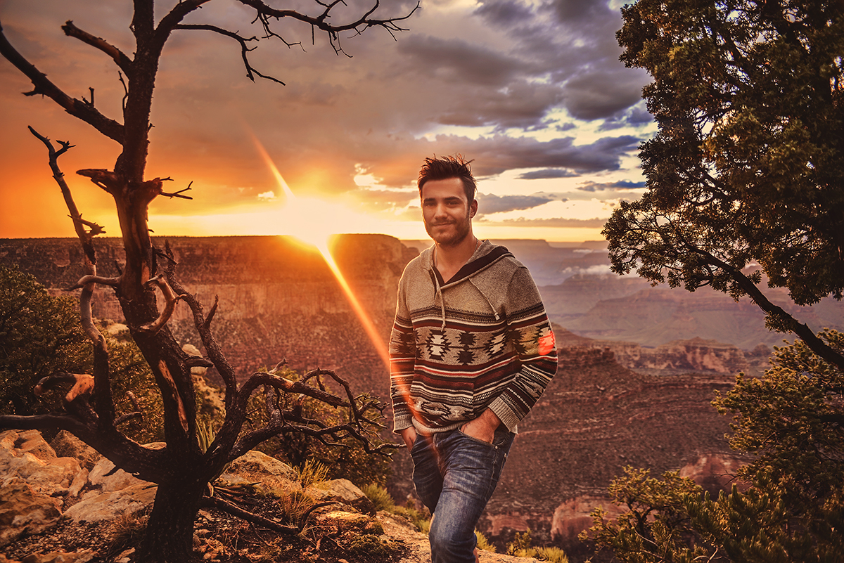 Man in cosy knit standing in front of Grand Canyon Sunset at Mather Point