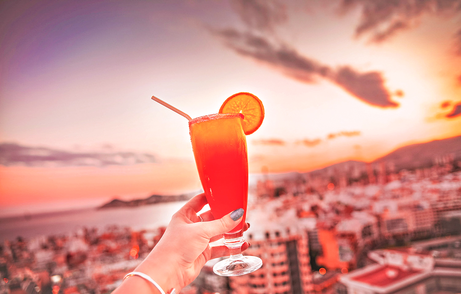Red Cocktail + sunset at Madeira Centro Rooftop Bar in Benidorm