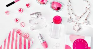 Flatlay with Gucci Bamboo Eau de Toilette & Stella McCartney Pop EdP, candy & jewelry