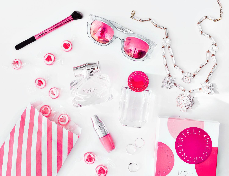 Flatlay with Gucci Bamboo Eau de Toilette & Stella McCartney Pop EdP, candy & jewelry