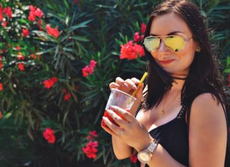 Me wearing Ray Ban Flash Lenses and holding a glass of strawberry slush