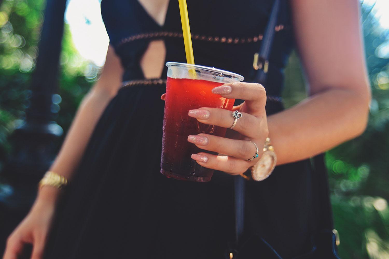 Holding a glass of strawberry slush