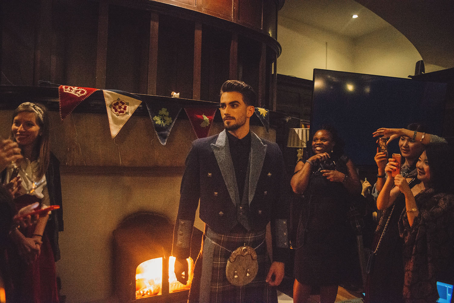 Siobhan Mackenzie Scottish Fashion Show with hot male model wearing kilt