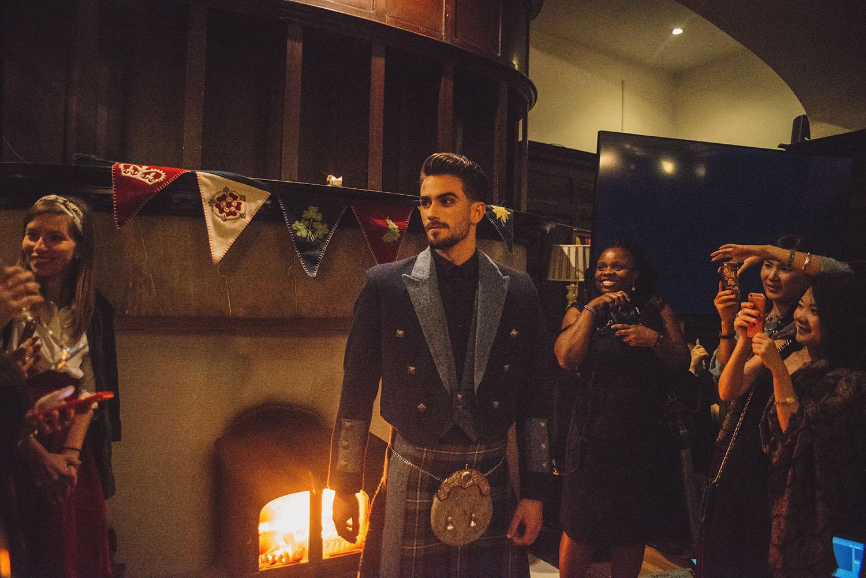 Siobhan Mackenzie Scottish Fashion Show with hot male model wearing kilt