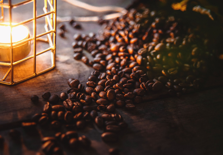 Coffe beans in candle light - The Nescafé Plan