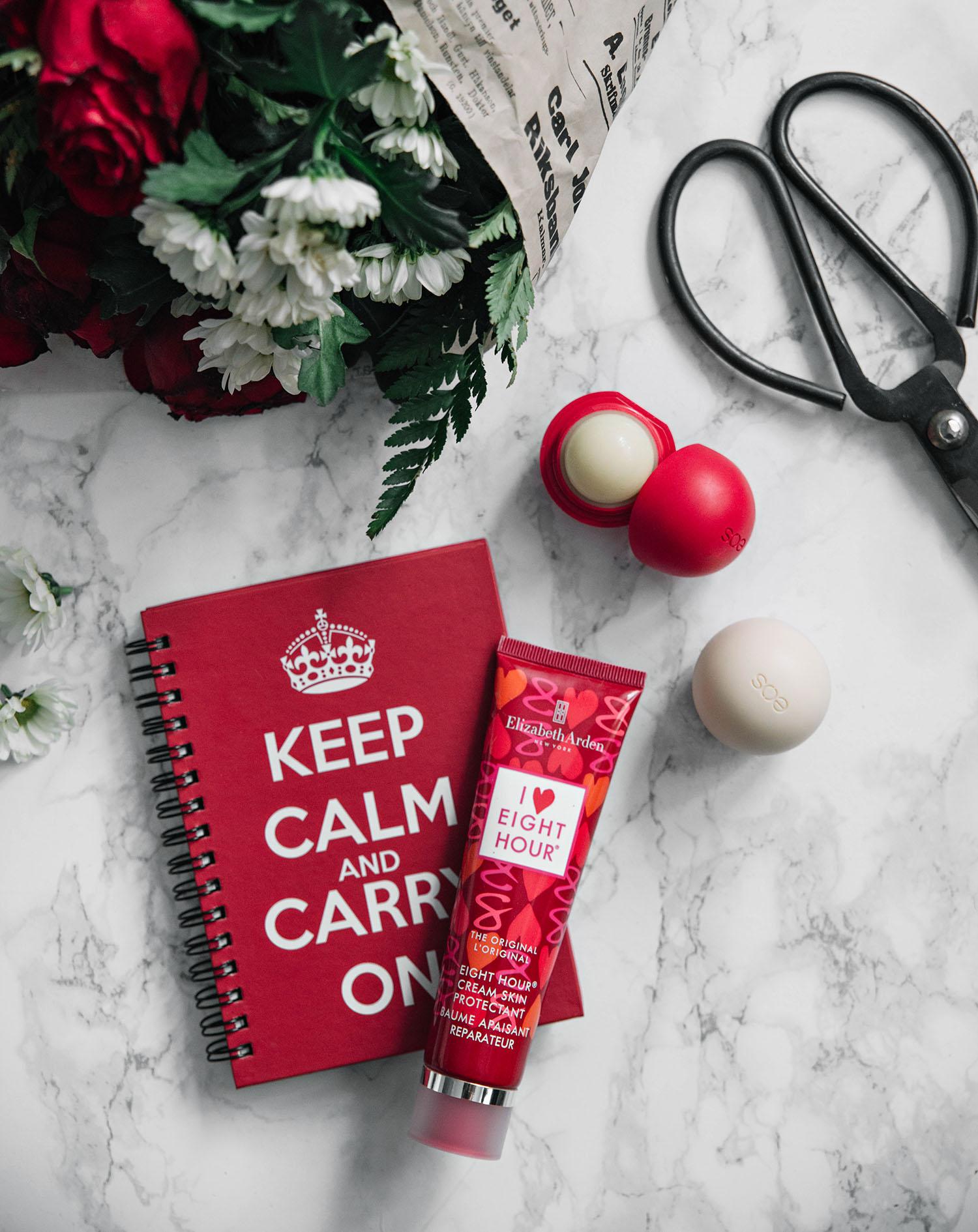 Flatlay with Elizabeth Arden Eight Hour Skin Protectant Cream & Eos, flower bouquet & old scissor