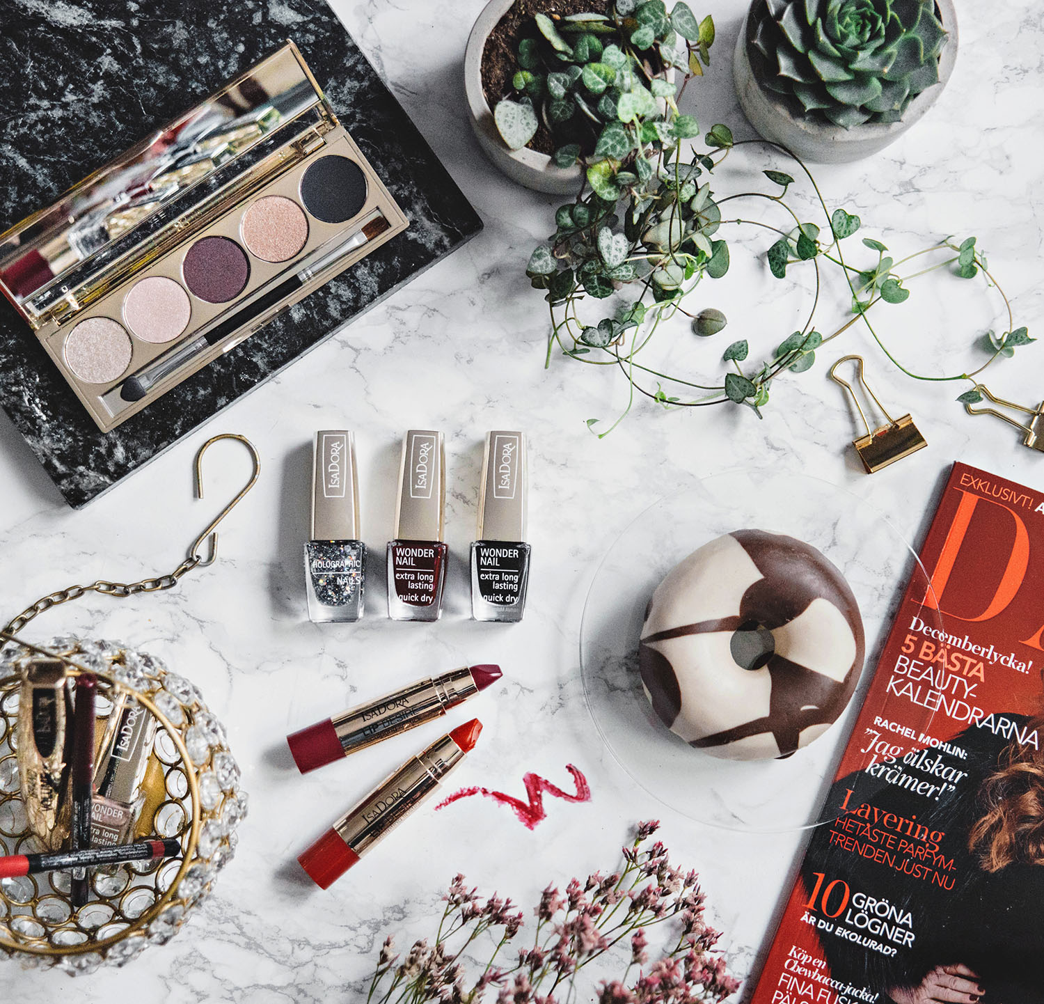 Flatlay with donut, magazine and IsaDora Boho Baroque Holiday Makeup 2016