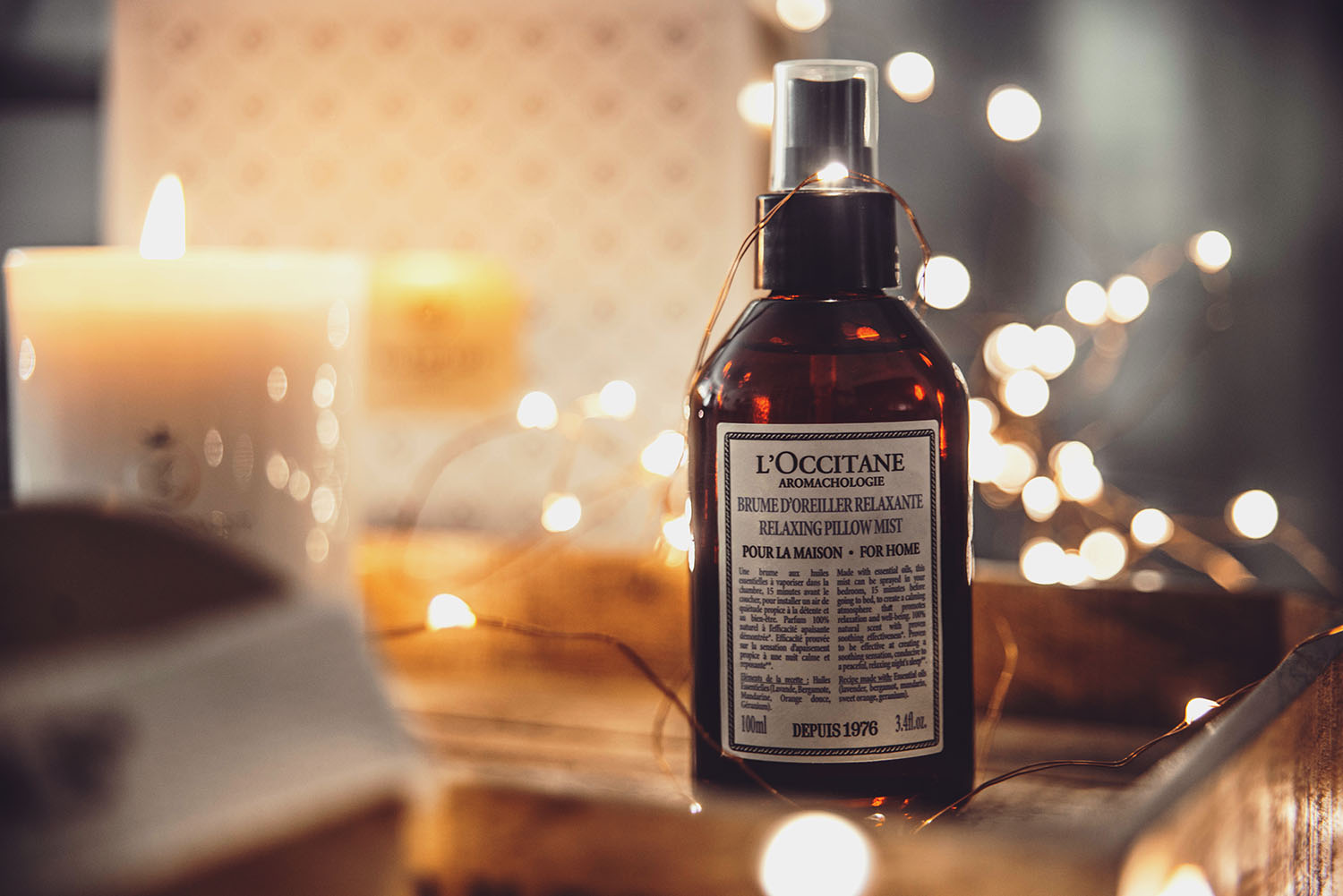 L'OCCITANE Relaxing Pillow Mist & Bokeh background