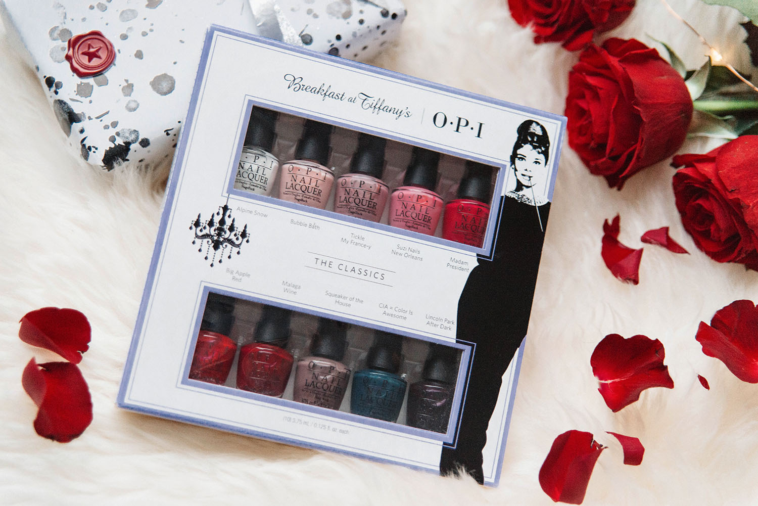 Flatlay with OPI Breakfast at Tiffanys pack with scattered roses