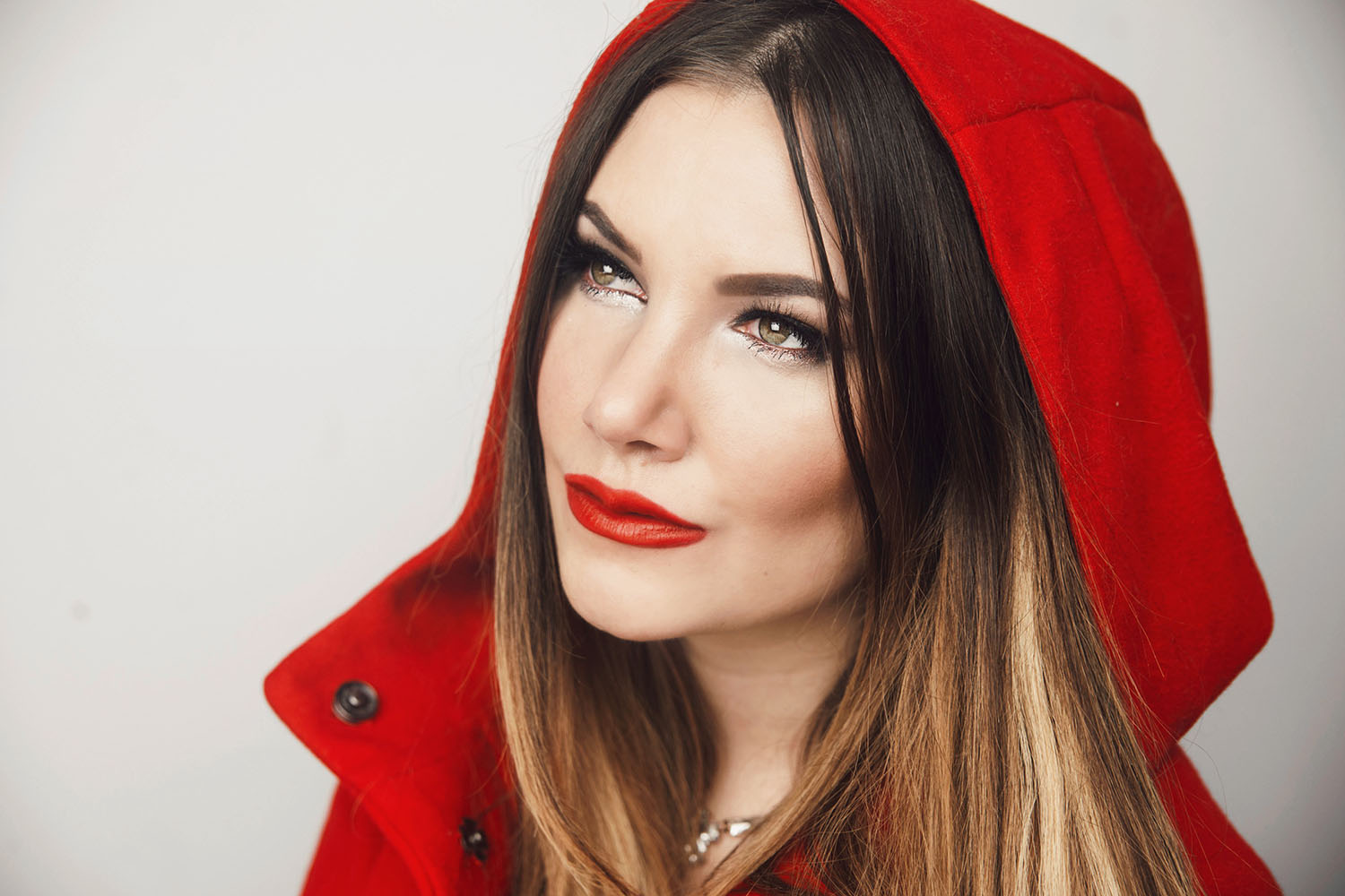 Portrait of woman wearing red riding hood