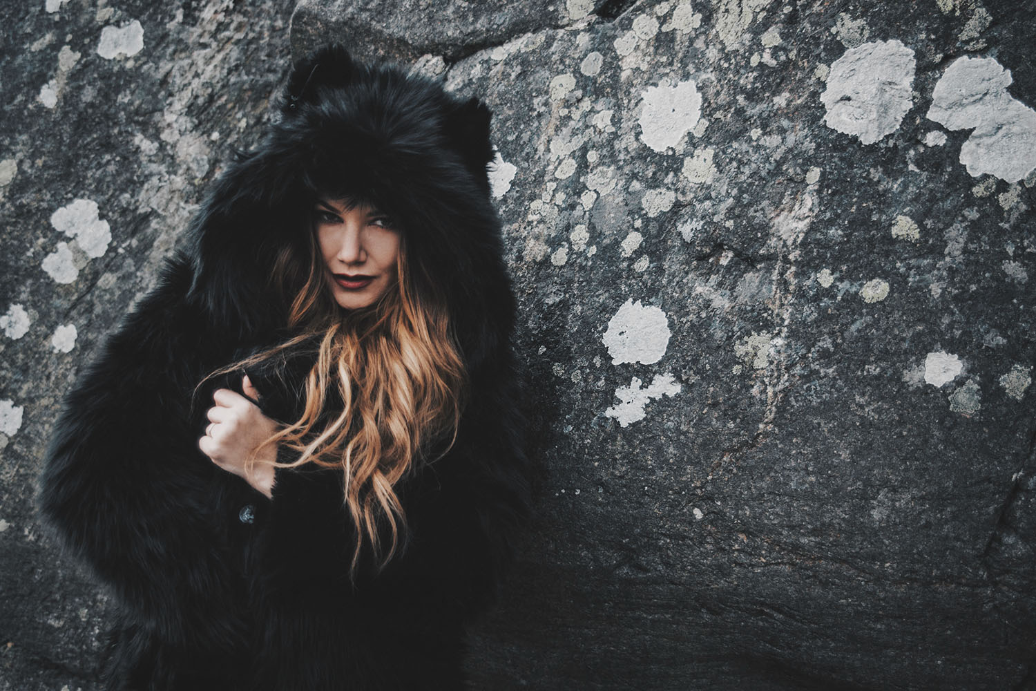 Woman with black faux fur coat with ears from Spirithood