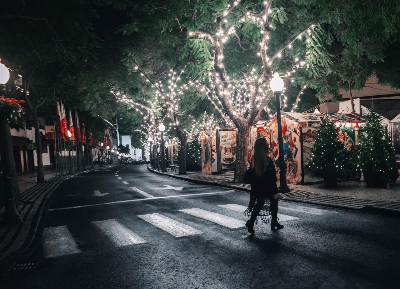 Woman walking across street in Madeira