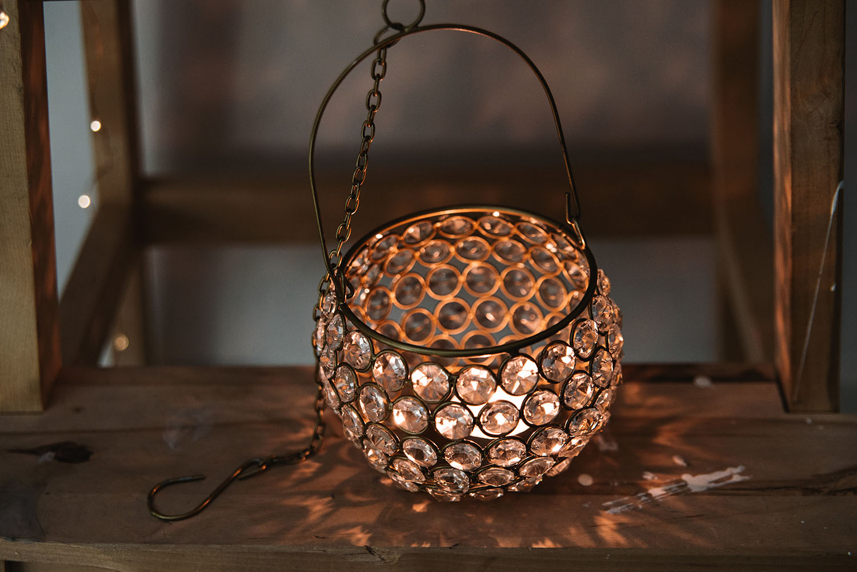 Hanging Prisma Lantern from Indiska on wood