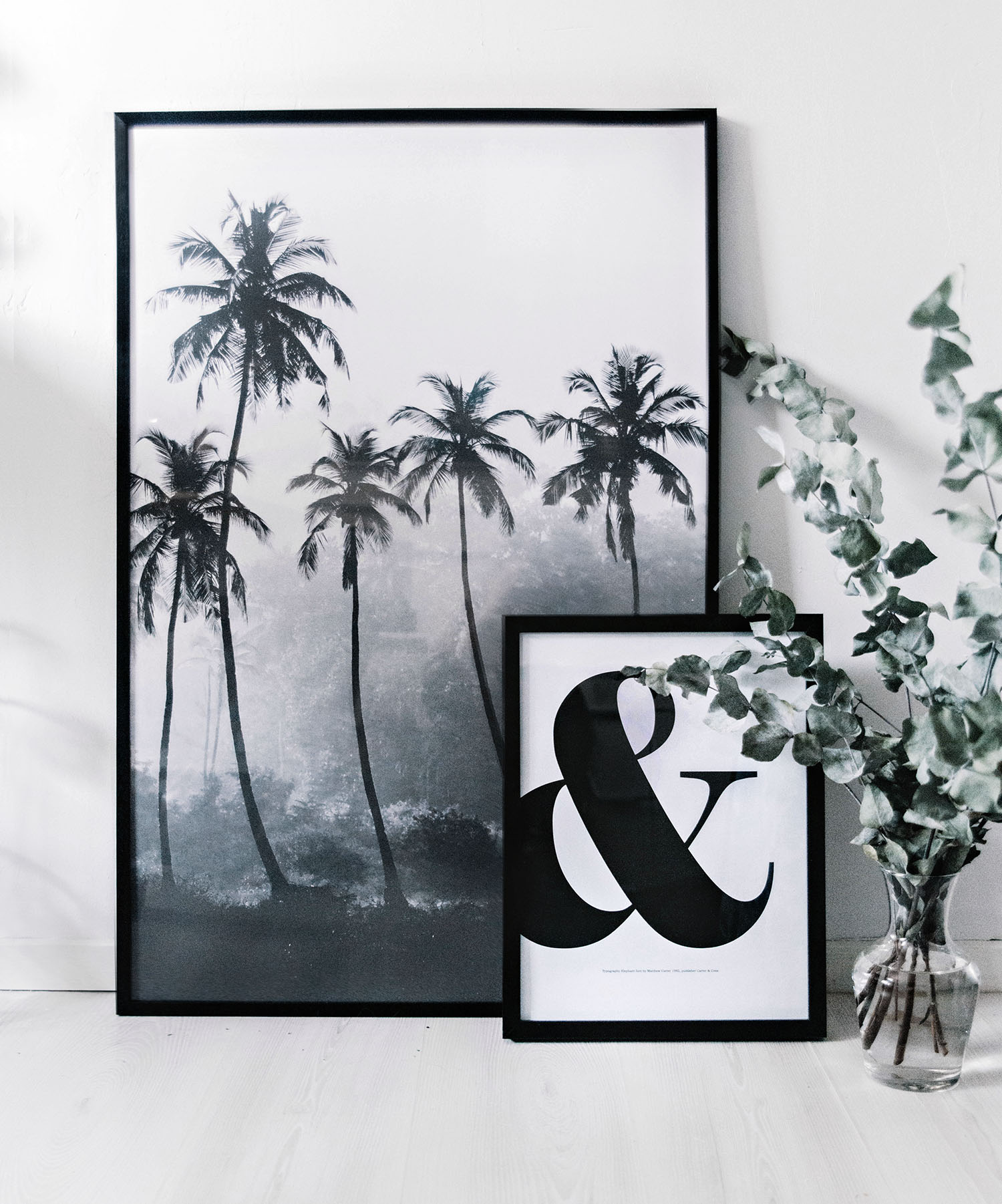 Palm trees and & letter posters on floor