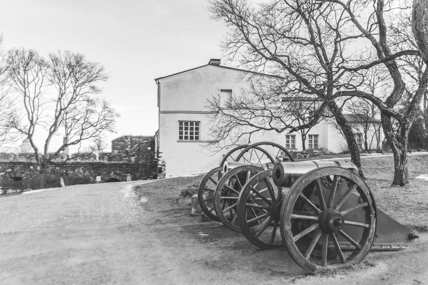 Black and white picture of cannons at Suomenlinna Island in Helsinki
