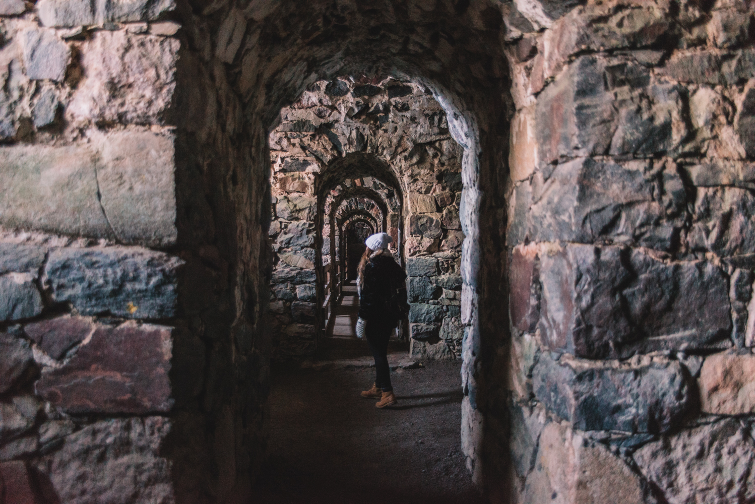 Woman walking in Suomenlinna Sea Fortress in Helsinki