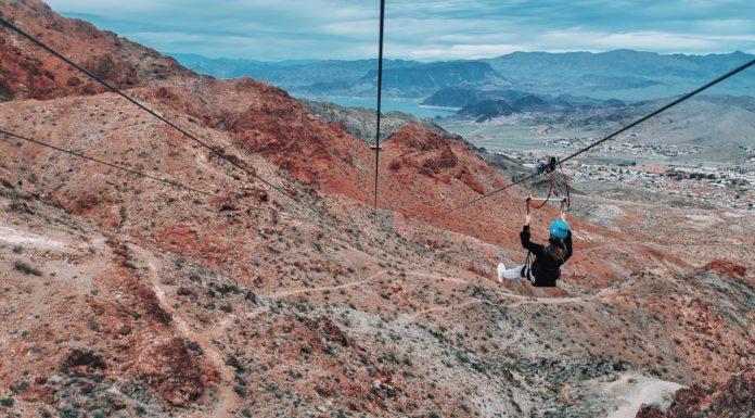 Photo of woman ziplining over the Mojave Desert with Flightlinez