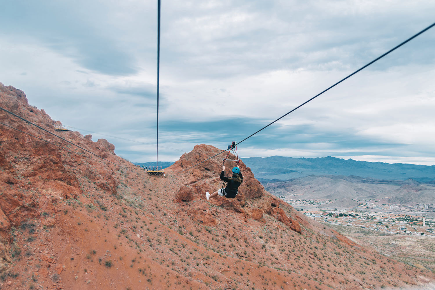 Photo of woman ziplining over the Mojave Desert with Flightlinez