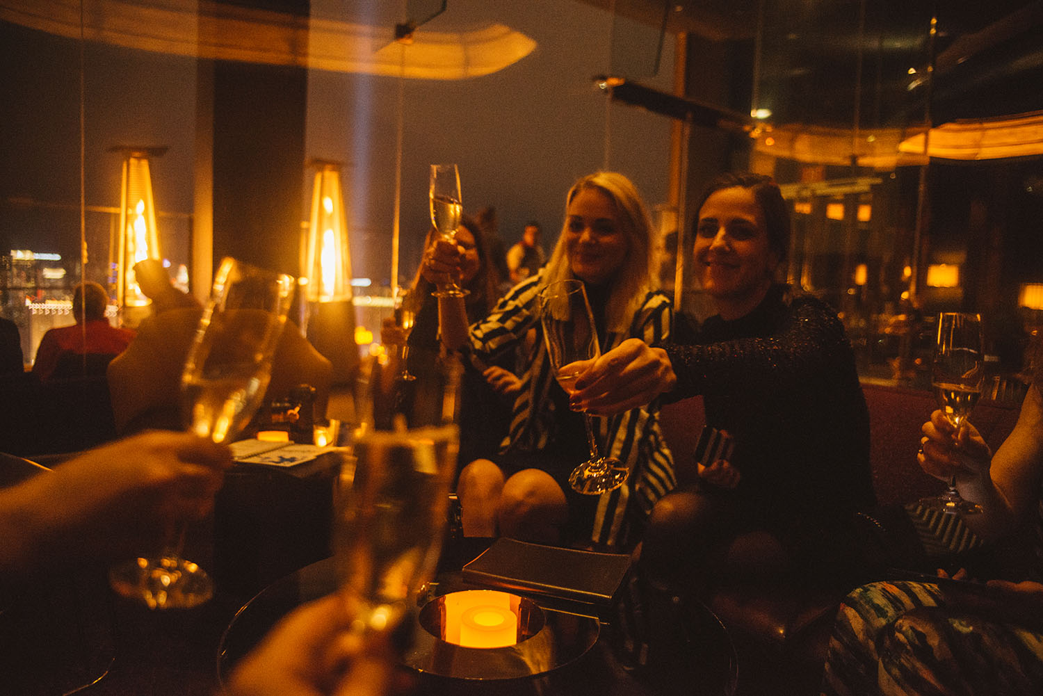 Women toasting in Skyfall Lounge at Delano