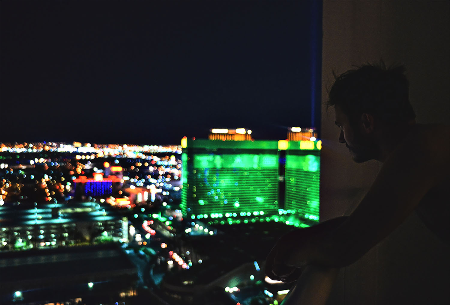 Man standing on balcony at The Signature at MGM Grand