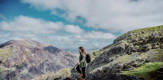 Girl with backpack walking in Clogwyn, Snowdonia National Park in Wales - King Arthur: Legend of the Sword Filming Location in Wales