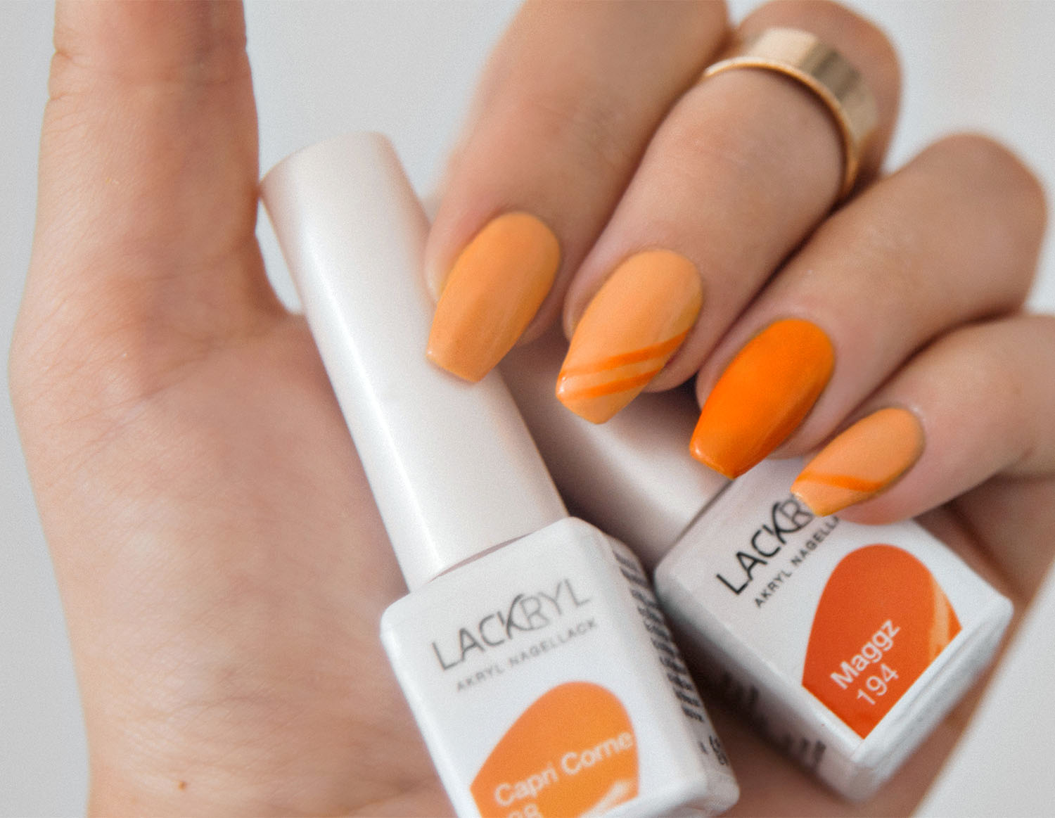Lackryl Capri Corne & Maggz - Orange Nail Design
