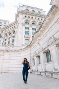 Standing in front of Palace of Parliament, Bucharest, Romania