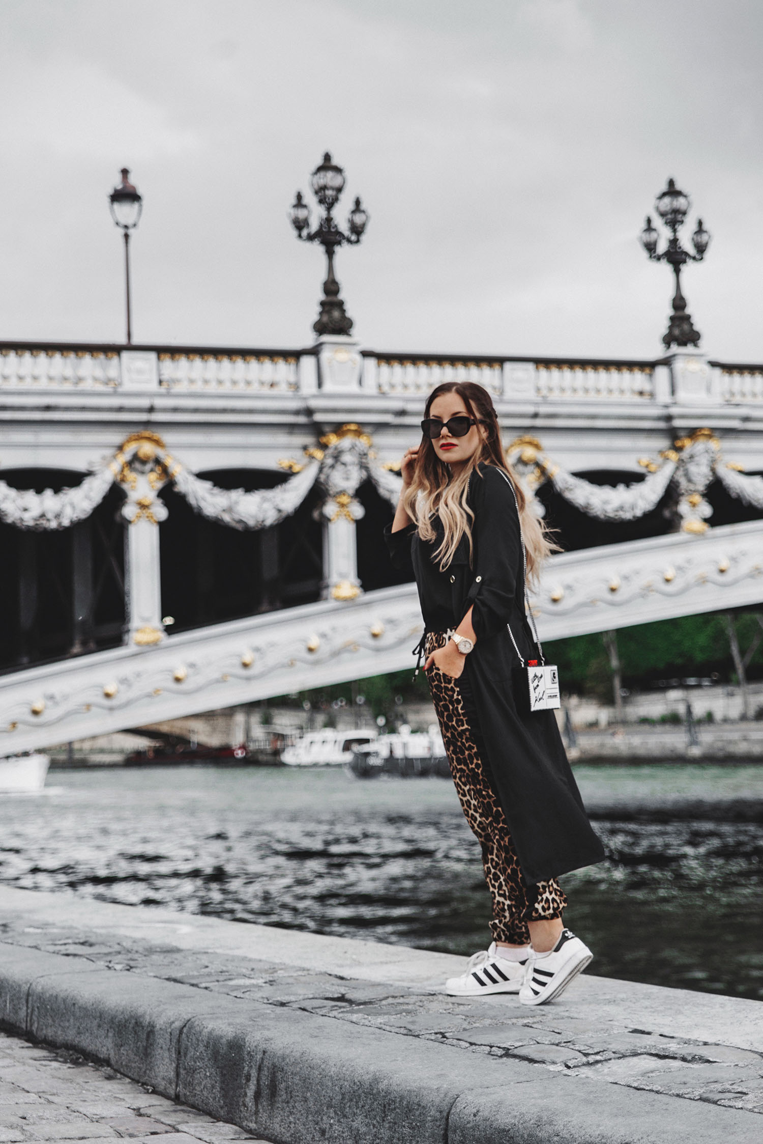 Travel in Style Outfit Idea with Leopard Pants, Black Cardigan & Karl Lagerfeld Clutch