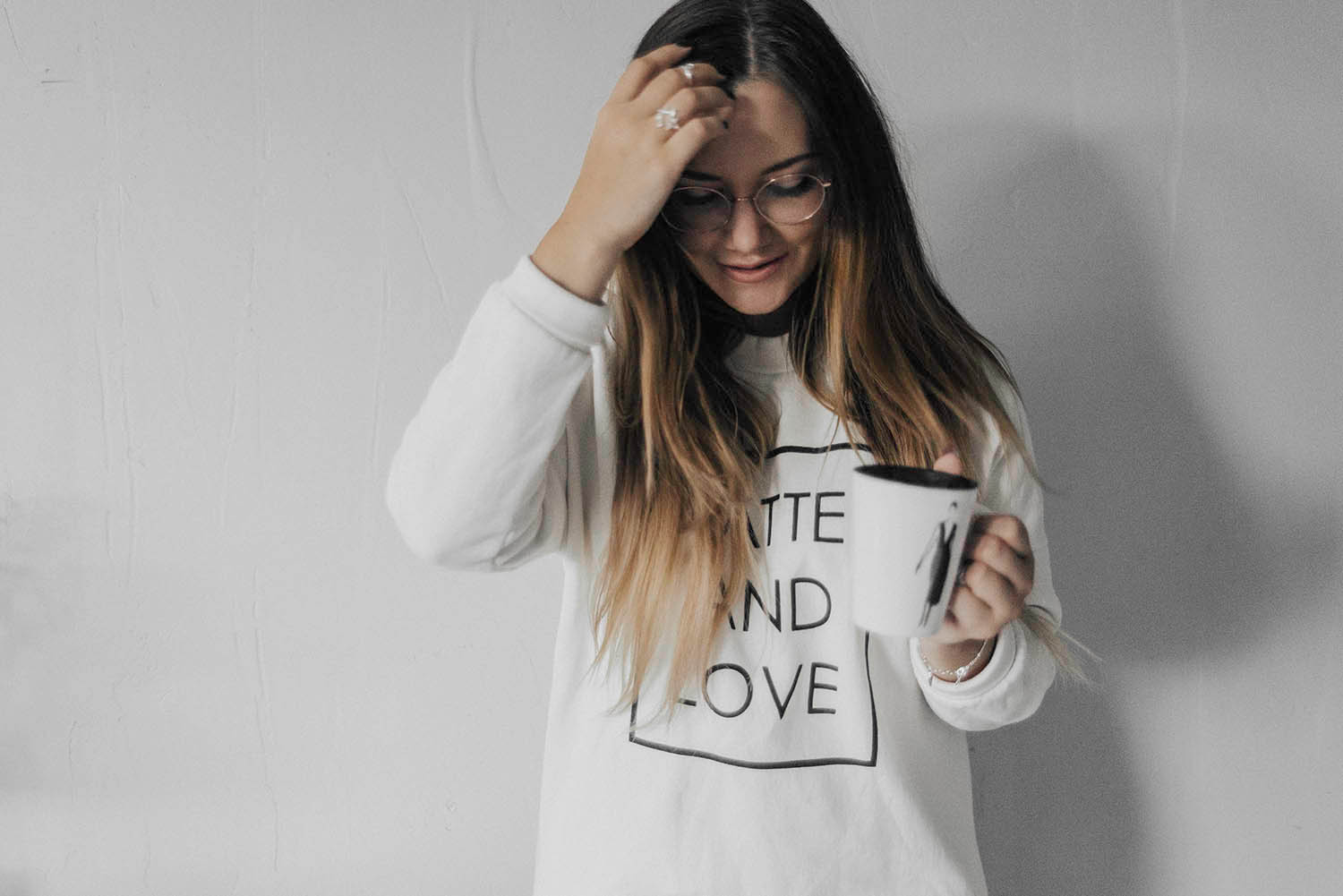 Latte and Love - Girl with glasses holding coffee cup